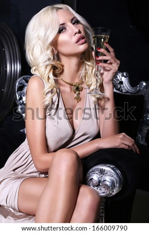 beautiful girl with blond hair with champagne - stock photo