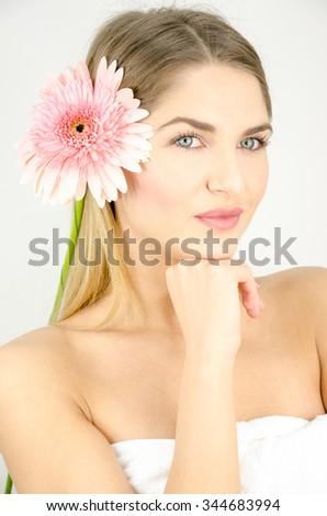 Beautiful girl with blonde hair enjoying the beauty salon - stock photo