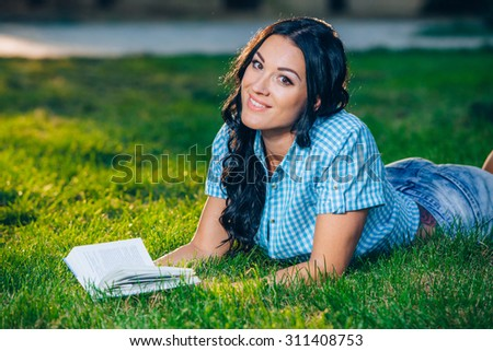 beautiful girl with book in the autumn park.