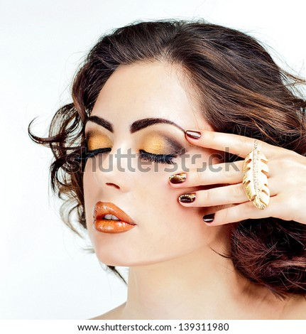 Beautiful girl with bright make-up, gold lips, face - stock photo
