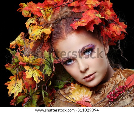 Beautiful girl with bright makeup isolated on black background. Fantasy girl portrait. Autumn fairy portrait