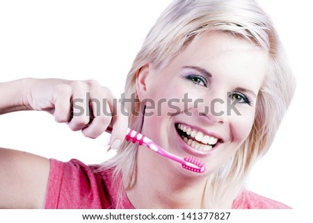 Beautiful girl with brushes his teeth.