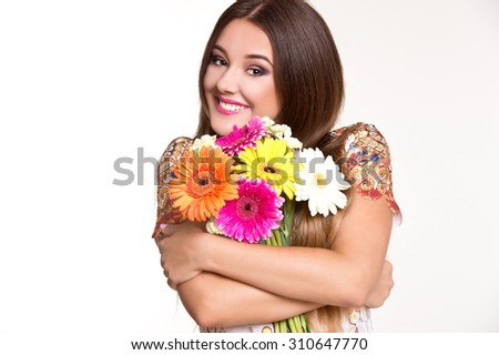 Beautiful girl with bunch of flowers - stock photo
