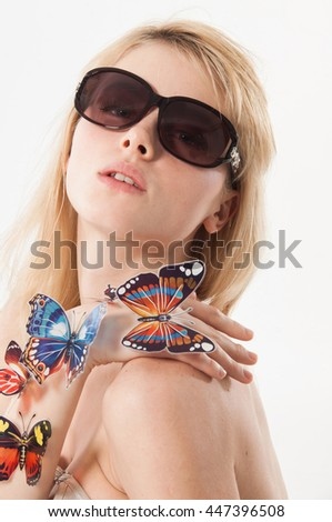 Beautiful Girl With Butterfly. Beauty Face - stock photo