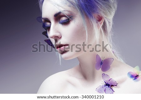 Beautiful Girl With  Butterfly. Beauty Face. Creative Make up and Hair Style. portrait with toning - stock photo