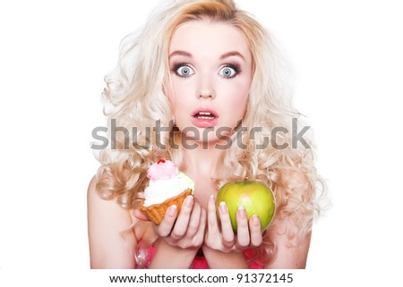 beautiful girl with cake and apple - stock photo