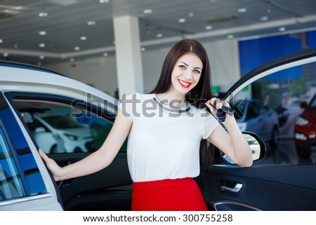 Beautiful girl with car keys. buying