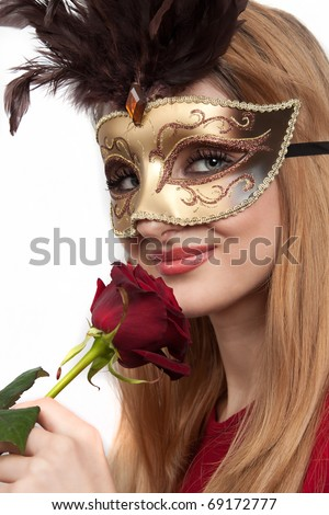 Beautiful girl with carnival mask and rose