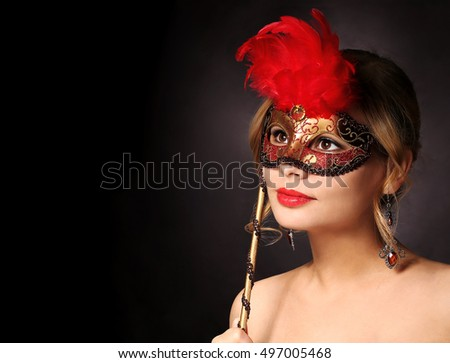 Beautiful girl with carnival mask. Halloween. Masquerade