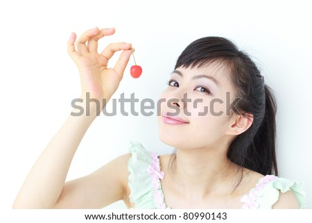 Beautiful girl with cherry isolated on white background
