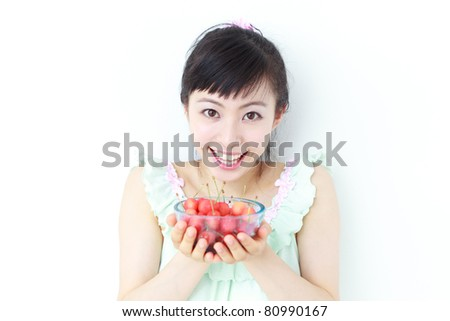 Beautiful girl with cherry isolated on white background - stock photo