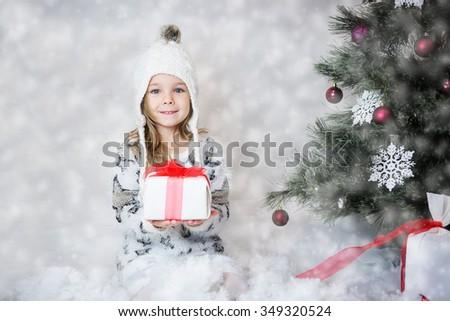 Beautiful girl with Christmas gift - stock photo