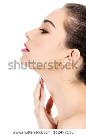 Beautiful girl with clean fresh skin touches her neck, white background