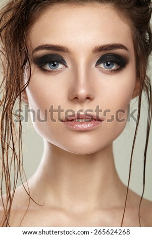 Beautiful girl with clean skin and wet hair - stock photo