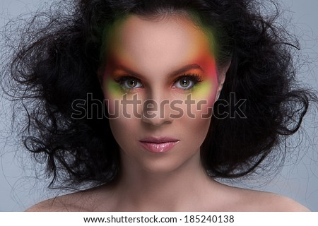 Beautiful girl with colored make-up