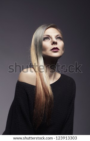 beautiful girl with colorful hairsytle  on dark background