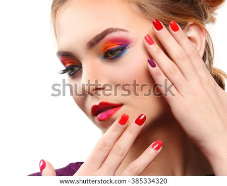Beautiful girl with colorful makeup and manicure, isolated on white