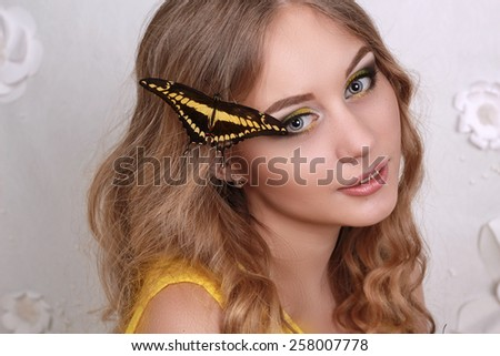 Beautiful girl with colorful tropical butterflies - stock photo