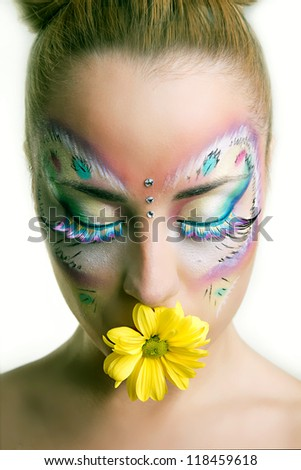 beautiful girl with creative make-up - stock photo