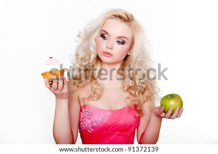 beautiful girl with cupcake and apple - stock photo