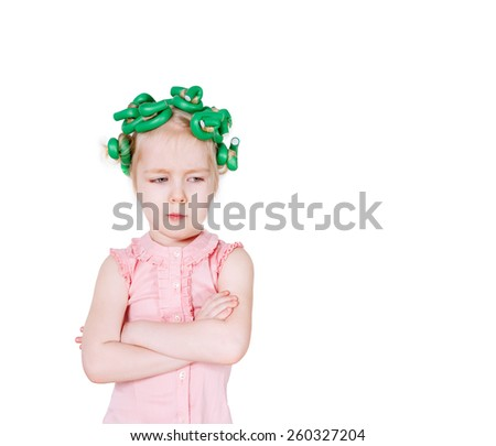 Beautiful girl with curlers on her head - stock photo