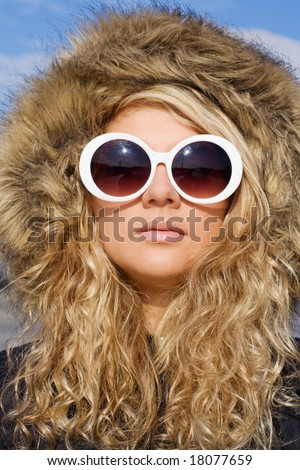 Beautiful girl with curly hair in white sun glasses - stock photo