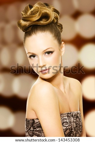 Beautiful girl with curly hairstyle and bright makeup - stock photo