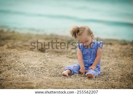 beautiful girl with Down syndrome on the beach