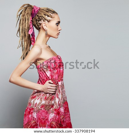 beautiful girl with dreadlocks.beauty young woman with African braids hairstyle. pink dress - stock photo