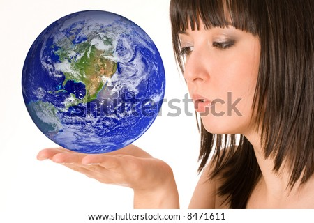 Beautiful girl with earth in hand