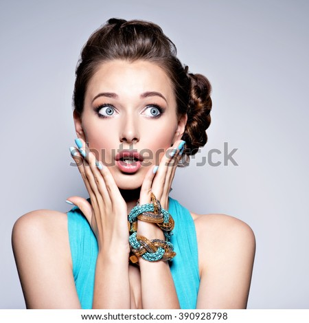 Beautiful girl with expressive emotions. Young woman with surprised face - stock photo