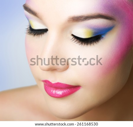 Beautiful girl with fashion bright makeup on light background - stock photo
