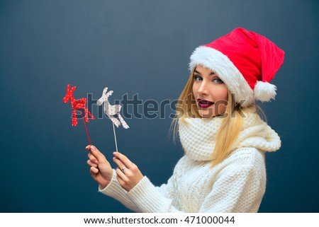 beautiful girl with figures of deer in Christmas