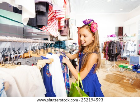 Beautiful girl with flower accessory in shop
