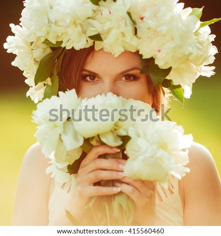 Beautiful girl with flower bouquet outdoors