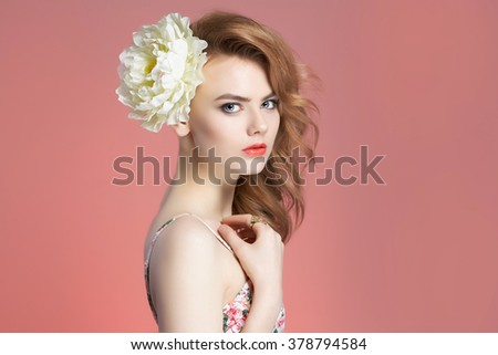 beautiful girl with flower in hair. beauty spring young woman over pink background