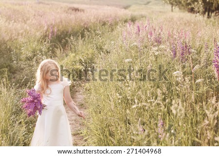 beautiful girl with flowers - stock photo