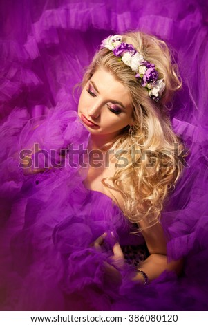 Beautiful Girl With  Flowers.Beauty Model Woman Face. Perfect Skin. Professional Make-up.Makeup. Fashion Art - stock photo