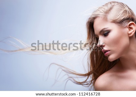 Beautiful girl with flying hair - stock photo