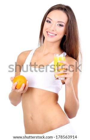 Beautiful girl with fresh juice isolated on white - stock photo