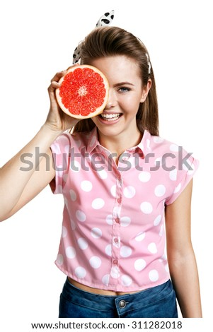 Beautiful girl with fresh ripe grapefruit slice, health and beauty care concept / photo of young cheerful brunette woman over white background, positive emotions - stock photo