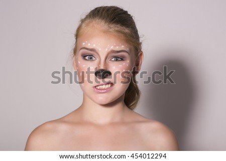 Beautiful girl with funny make-up, expresses different emotions. Funny image of beautiful pretty girl - stock photo