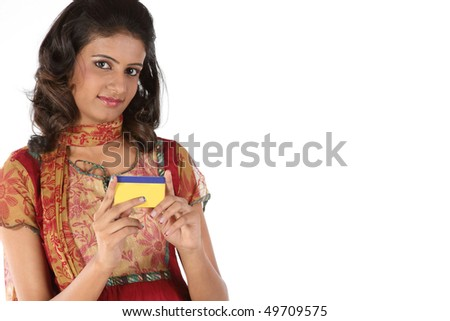 Beautiful girl with gold card - stock photo