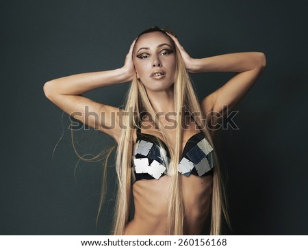 Beautiful girl with gorgeous hair posing on her knees - stock photo