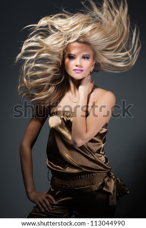 Beautiful girl with great fly-away hair - stock photo