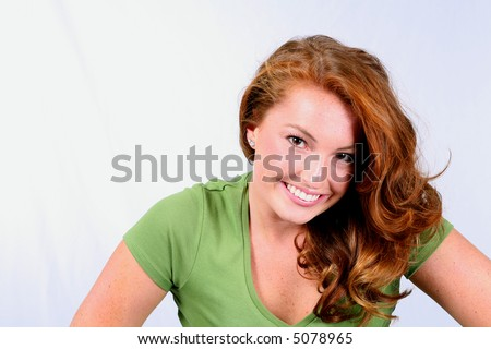 beautiful girl with great red hair and perfect teeth