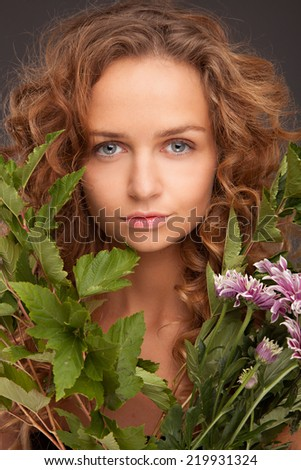 Beautiful Girl With green Flowers. Beauty Face - stock photo