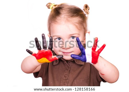 Beautiful girl with hands painted as German and French flags isolated on white. Study languages and travelling concept.