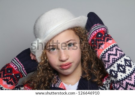 Beautiful girl with hat posing