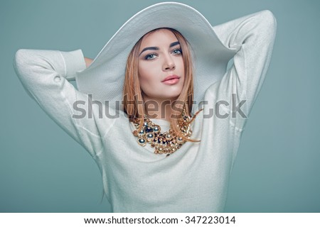 beautiful girl with hat posing in studio - stock photo
